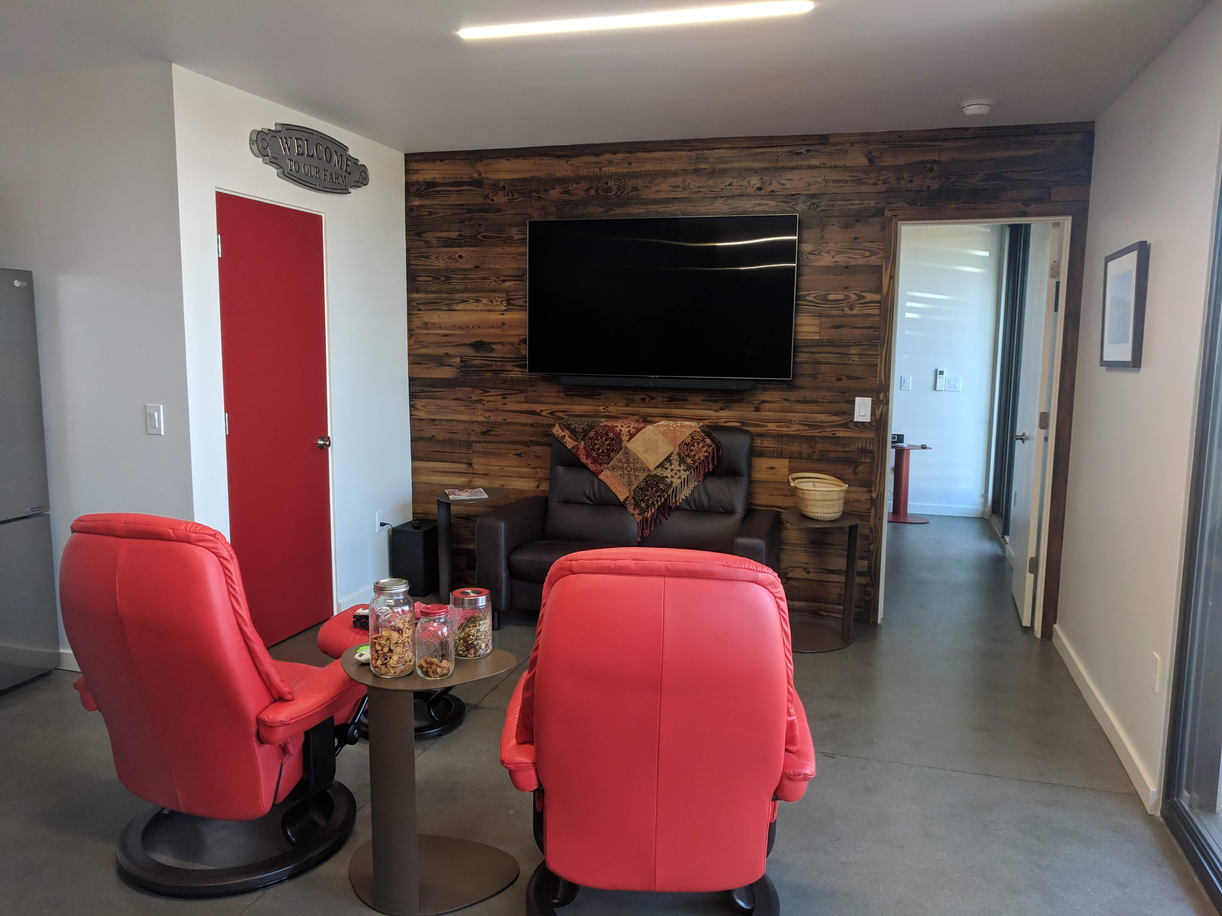 The Brooks used red accents, dark wood and as much glass as possible to create a modern, naturally-lit feel to the home.