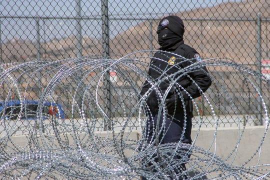 A Border Patrol agent guards the border at Tijuana.