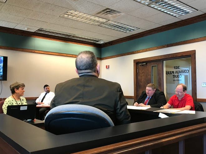 Port Clinton Safety-Service Director Olen Martin, who was fired and then reinstated last month, took the stand on Monday to testify in a hearing on a city employee's petition for a protection order against former Mayor Hugh Wheeler.
