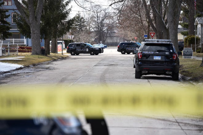 Officers respond to a report of possible shots fired on 13th Street in Port Huron Monday, April 1, 2019. Police have closed Gordon Street between 13th and 14th streets.