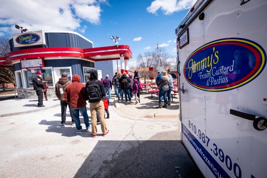People gather outside of Jimmy's Frozen Custard for free cone day Monday, April 1, 2019.
