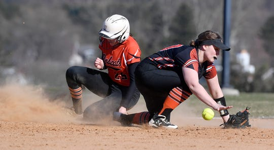 Central York's Natalie Craig bobbles the ball as  Haley Updegraff of Northeastern slides safely into third, Monday, April 1, 2019.