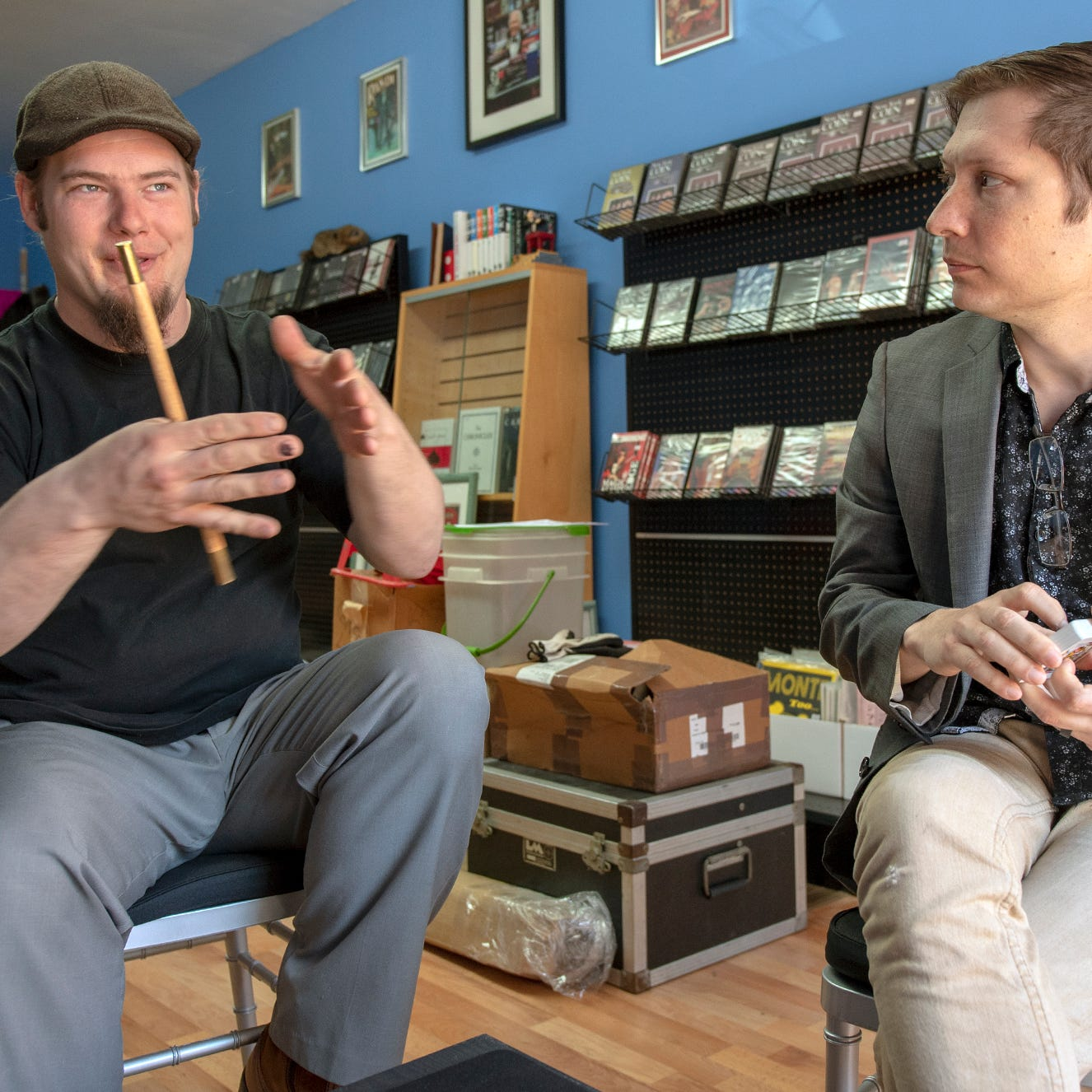 Jesse McCarley, left, and Cam McMillion describe the how their personalities define their magic shows at D&L Magic Shop in the first block of South Beaver Street in York.