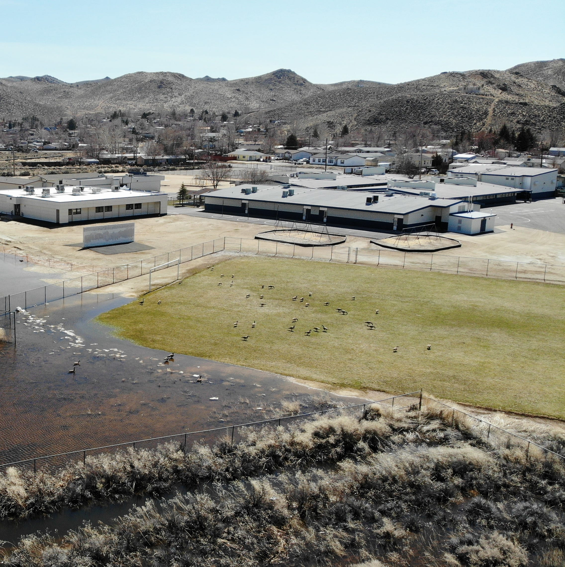 Drone footage shows flooded Lemmon Valley school playground, WCSD has installed fencing