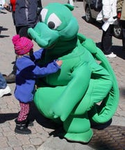 Tessie -- in mascot form -- greets a youngster at an Earth Day celebration at the Village at Squaw Valley.