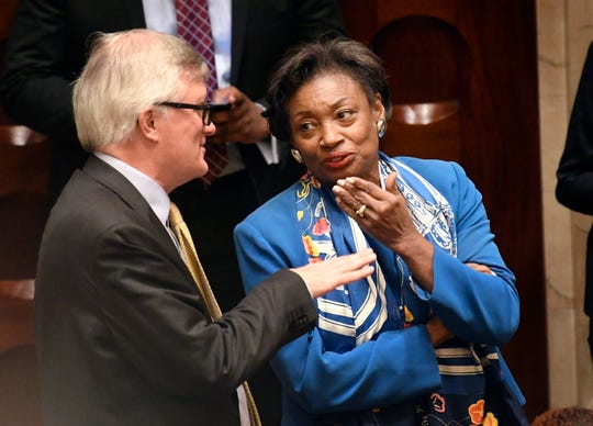 Sen. Brian Kavanagh, D- New York, left, speaks with Senate Majority Leader Andrea Stewart-Cousins, D-Yonkers, as Senate members debate budget bills in the Senate Chamber at the state Capitol, Sunday, March, 31, 2019, in Albany, N.Y.