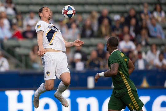 LA Galaxy forward Zlatan Ibrahimovic (9) jumps to recover the ball during the first half against the Portland Timbers at StubHub Center.