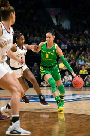 Mar 31, 2019; Portland, OR, USA; Oregon Ducks forward Satou Sabally (0) drives to the basket against Mississippi State Bulldogs forward Anriel Howard (5) during the first half in the championship game of the Portland regional in the women's 2019 NCAA Tournament at Moda Center. Mandatory Credit: Troy Wayrynen-USA TODAY Sports