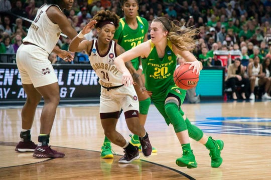 Mar 31, 2019; Portland, OR, USA; Oregon Ducks guard Sabrina Ionescu (20) drives past Mississippi State Bulldogs guard Jordan Danberry (24) during the second half in the championship game of the Portland regional in the women's 2019 NCAA Tournament at Moda Center. The Oregon Ducks beat the Mississippi State Bulldogs 88-84. Mandatory Credit: Troy Wayrynen-USA TODAY Sports
