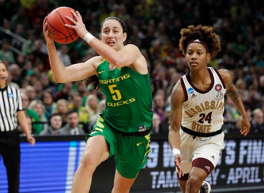 Oregon guard Maite Cazorla, left, drives to the basket against Mississippi State guard Jordan Danberry, right, during the second half of a regional final in the NCAA women's college basketball tournament Sunday, March 31, 2019, in Portland, Ore. Oregon defeated Mississippi State 88-84. (AP Photo/Steve Dipaola)