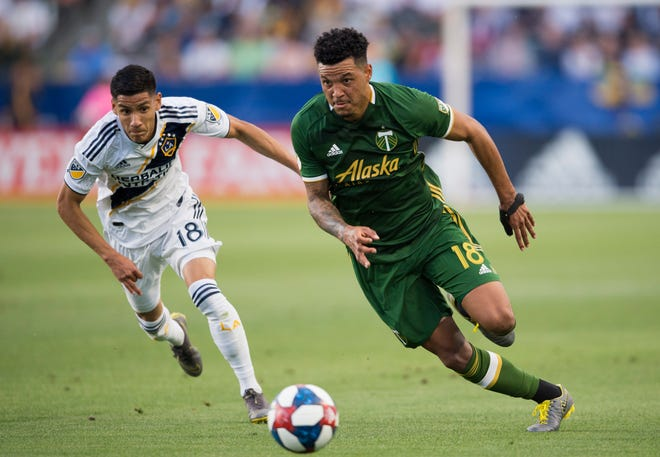 Portland Timbers defender Julio Cascante, right, moves the ball ahead of LA Galaxy midfielder Uriel Antuna during a 2019 game. Cascante could be headed to Austin FC in a trade next week, according to a report.