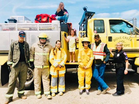 Sophie poses with members of the San Angelo Police Department and Dove Creek Volunteer Fire Department Saturday, March 30, 2019.