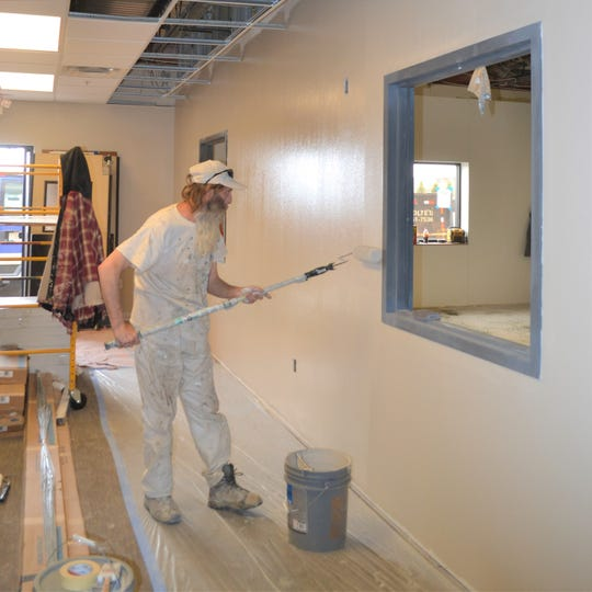 A worker paints the walls of Feeding South Dakota's new cleanroom on March 28, 2019. The room will allow the nonprofit to buy and repackage bulk products for individual consumption without the fear of cross-contamination.