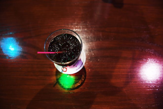 Sioux Falls bars are having to make difficult decisions whether or not to turn off the lights.
