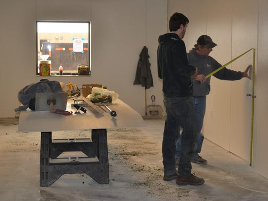 Contractors work on measuring the walls of Feeding South Dakota's new cleanroom on March 28, 2019. The room will allow the nonprofit to buy and repackage bulk products for individual consumption without the fear of cross-contamination.