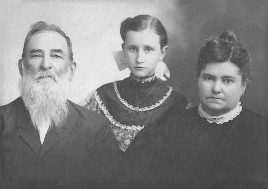 "A family portrait of Franklin ""Frank"" Plummer, Mary Hellen Plummer and Mary E. ""Molly"" Jones-Plummer taken about 1905."