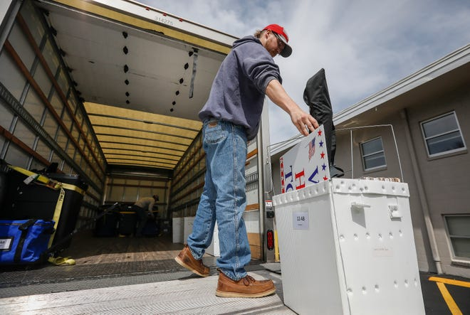 Justin Keith, of the Greene County Highway Department, unloads election equipment from a truck outside of Glenstone Baptist Church on Monday, April 1, 2019.