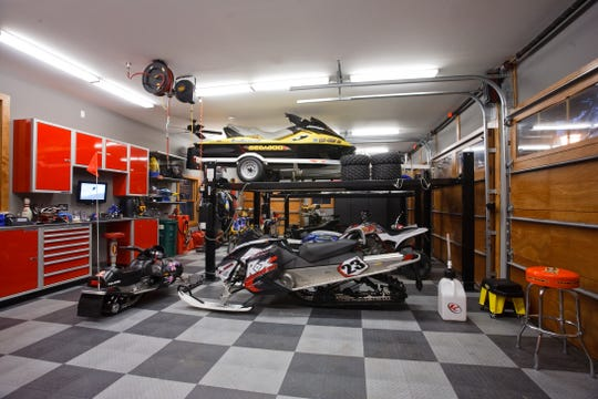 The first level of the detached garage boasts hydraulic automotive lifts, a mechanical room with a compressor and air lines and virtually anything else you could want in a man cave.