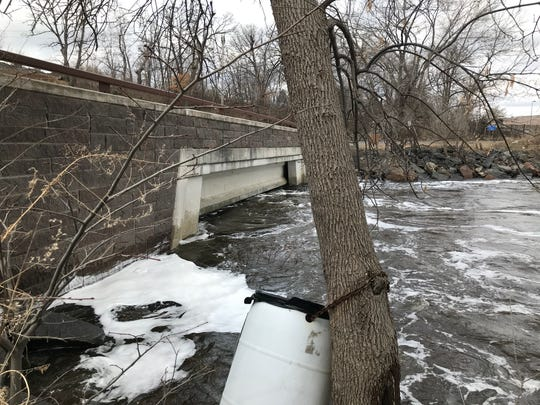 High water marked where Watab Creek and the Mississippi River converged Monday afternoon in Sartell.