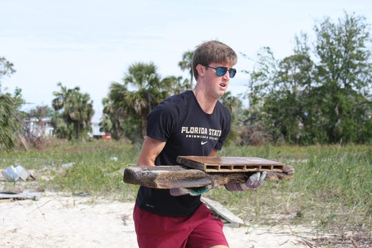 FSU swimmer Patrick Butkovich put together Sunday's clean-up day for FSU student-athletes in Panama City.