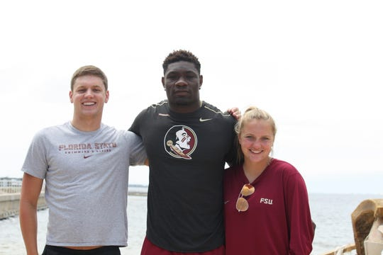 FSU swimmer Chad McGuire (left), FSU football player Janarius Robinson (center) and FSU soccer player Taylor Hallmon (right) are all natives of Panama City.