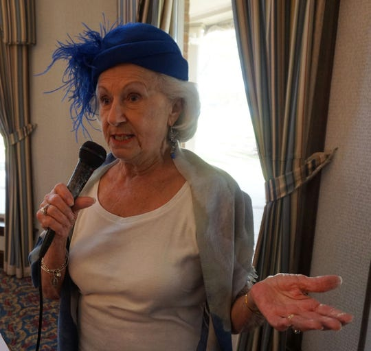 Rosemary Kemper,in her fine hat of yesteryear, promoted the club's annual fashion show, coming at its April luncheon.