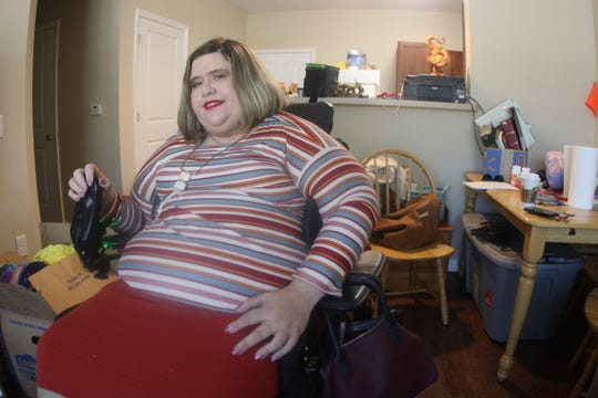 Amanda Baker, pictured March 5, is a  Panama City resident with a disability who recently moved into an apartment in Tallahassee. She says finding a new home that accommodated her needs through FEMA was a process that required hundreds of hours of negotiation.