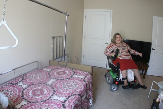 Amanda Baker, pictured March 5, is a Panama City resident who recently moved into an apartment in Tallahassee. She says finding a new home that accommodated her special needs through FEMA was a process that required hundreds of hours of negotiation.