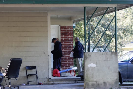 Leon County Schools Superintendent Rocky Hanna and Community Liaison Robert Crawford knock on the door of a home in Apalachee Ridge neighborhood where an 11-year-old fifth grader who has missed 24 days of school lives Thursday, Dec. 6, 2018.