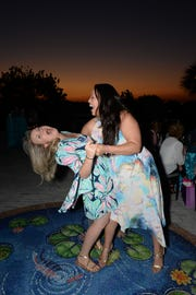 Katie Makemson, left, and Monica Lokitus share a laugh and a dip at Ladies' Night Out at The Mansion at Tuckahoe, a benefit for the Children's Museum of the Treasure Coast.