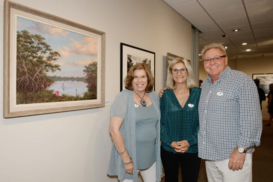 """Cynthia Putnam, left, and Joy and Otto Muller at the opening reception for """"Backus & Butcher and the Florida Landscape"""" at the A.E. Backus Museum & Gallery in Fort Pierce."""
