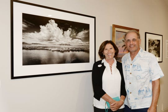 """Sally and John Wiesenfeld at the opening reception for """"Backus & Butcher and the Florida Landscape"""" at the A.E. Backus Museum & Gallery in Fort Pierce."""