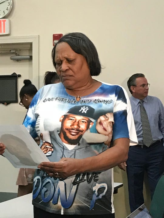 Aroma Phillips looks at a picture of the man accused of killing her son, Don Phillips II, in an October 2018 shooting in Indian River County. Phillips said she has never met the man, Richard Peterson, of Gifford.