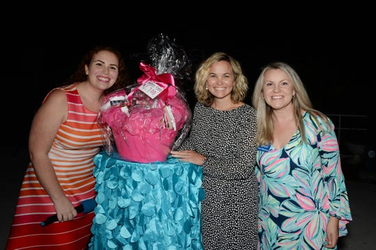 Marie Mahovetz, left, and Katie Makemson, right, of the Children's Musuem of the Treasure Coast with Grand Prize winner Chelsey Matheson, who took home over $2,700 in prizes from Ladies' Night Out at The Mansion at Tuckahoe.