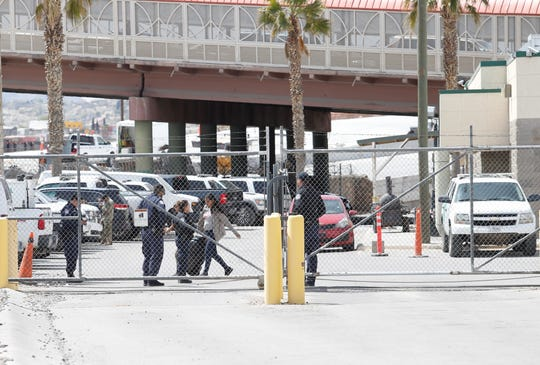 Customs and Border Protection stand guard at a processing facility near the Paso del Norte International Bridge in El Paso, TX.