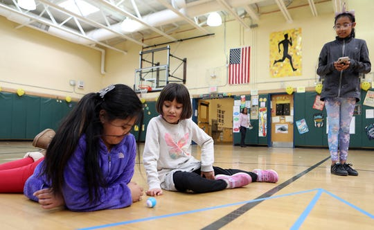 From left, Yessena Lopez, 9, Astrid Alvarez, 8, and Jessica Camacho, 9, work with a Mini Sphero's robotic during their after school STEAM program funded by a 21st Century grant by White Plains Youth Bureau at Post Road School in White Plains April 1, 2019. A federal program called 21st Century Learning Centers has been cut out of the Trump budget.