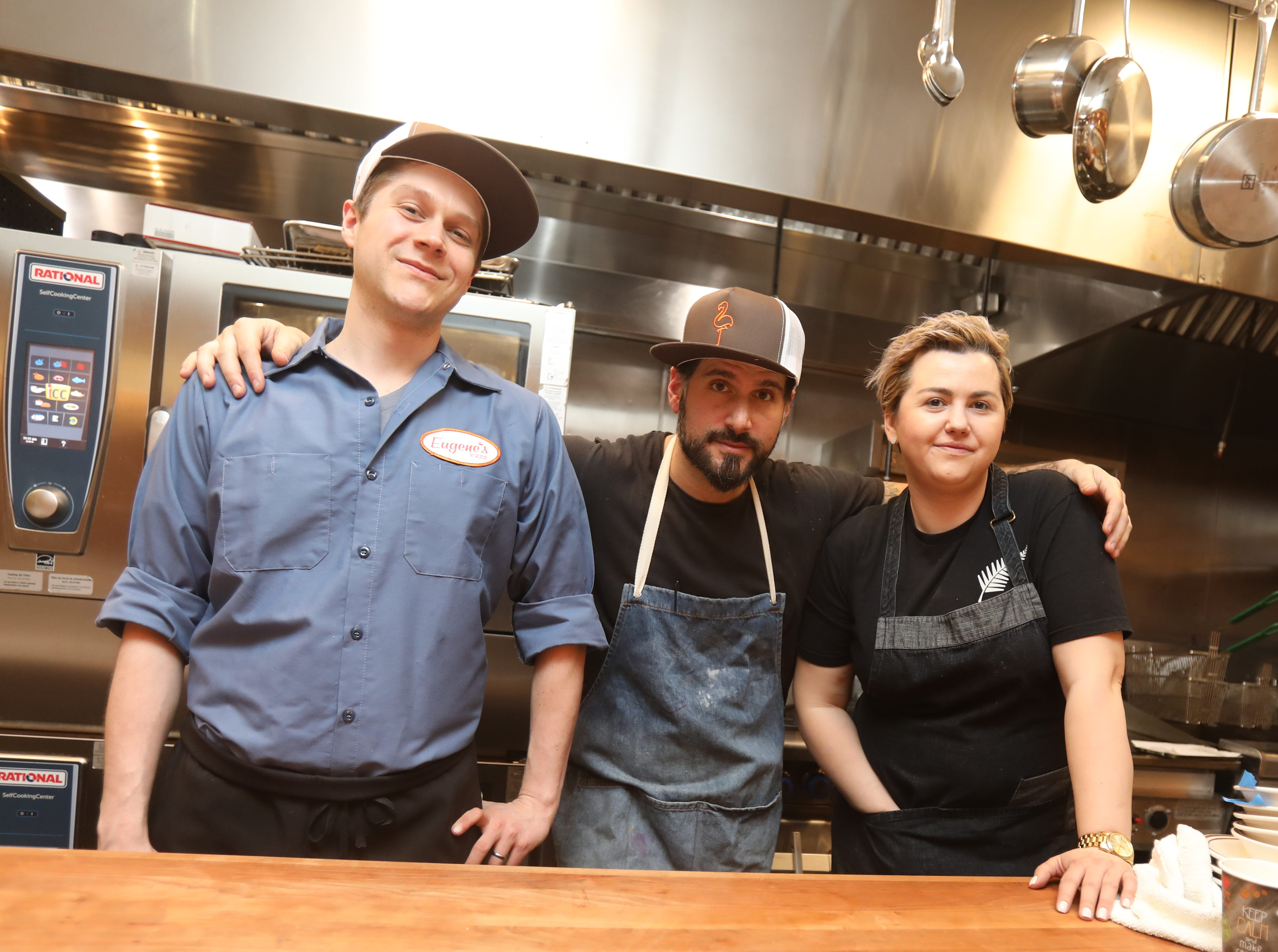 From left, John Poiarkoff, culinary director, Iulia Mahu, chef de cuisine, and David DiBari, owner are photographed at Eugene's in Port Chester March 29, 2019. The restaurant has a 70s-era basement vibe with wood panels, floral wallpaper, laminate counters, and their icon is a pink flamingo.