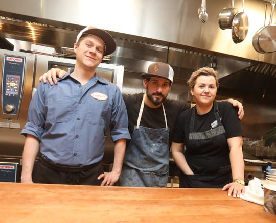 From left, John Poiarkoff, culinary director, Iulia Mahu, chef de cuisine, and Dave DiBari, owner, in the kitchen at Eugene's Diner & Bar in Port Chester March 29, 2019.