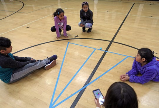 From left, Jonathan Tellez, 10, Eriana Joy-Begazo, 9, Jessica Camacho, 9, Yessena Lopez, 9, and Astrid Alvarez, 8, uses a phone to get Mini Sphero's robotic move on the line during their after school STEAM program funded by a 21st Century grant by White Plains Youth Bureau at Post Road School in White Plains April 1, 2019. A federal program called 21st Century Learning Centers has been cut out of the Trump budget.
