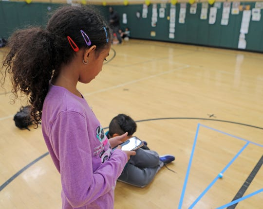 Eriana Joy-Begazo, 9, uses a phone to get Mini Sphero's robotic move on the line during an after school STEAM program funded by a 21st Century grant by White Plains Youth Bureau at Post Road School in White Plains April 1, 2019. A federal program called 21st Century Learning Centers has been cut out of the Trump budget.