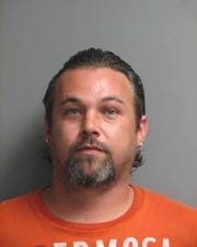 Christopher A. Henry, 37, was charged with second-degree assault, strangulation, malicious interference with emergency communications, and offensive touching.