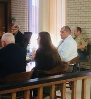 Murder defendant David Ybarra Jr., wearing a white shirt, sits Monday at the end of the defense counsel's table in Seymour. Others, from left, are attorneys Earl Griffin and Sage Seal and Bryan Vest, sheriff's deputy. Seated near the bench is Linda Conner, court administrator.