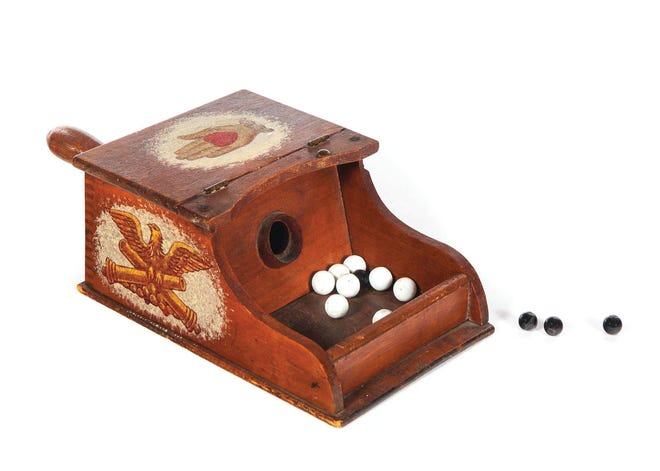 A blackball box and marbles used in Ohio in the early 1900s was auctioned at Garth's for $500. The box had machine-made dovetailing and was decorated with decoupage prints in painted frames.
