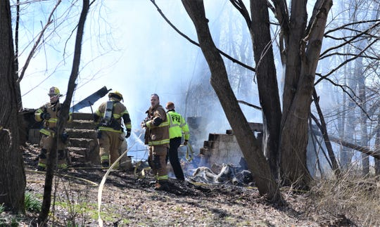 Three fire departments contain a fire at an abandoned home on Cranberry Lane near Nashport.