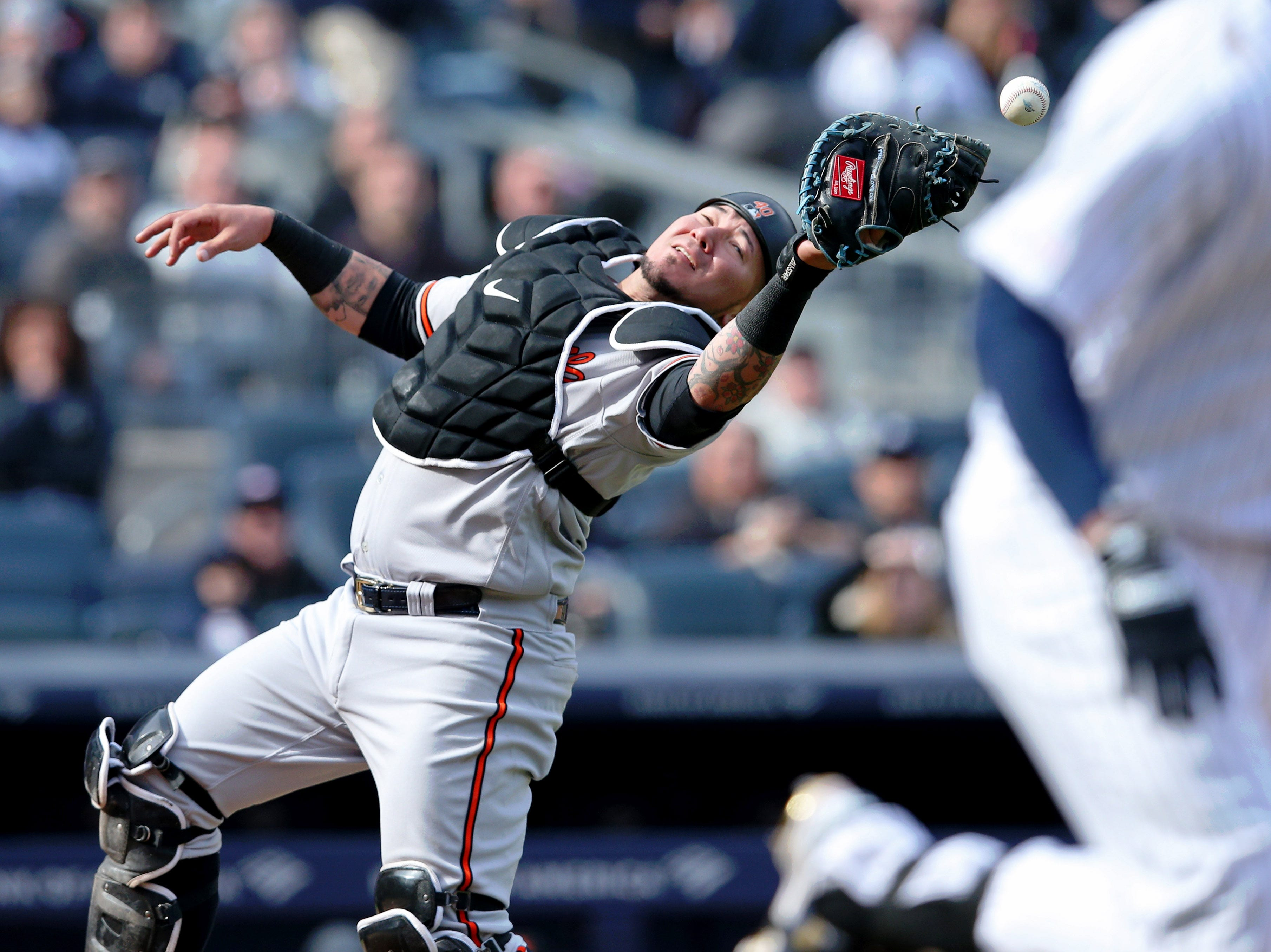 March 28: Orioles catcher Jesus Sucre drops a pop-up against the Yankees.