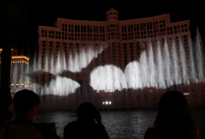 """A dragon is projected during a """"Game of Thrones""""-themed show at the fountains at the Bellagio casino-resort, Sunday, March 31, 2019, in Las Vegas."""