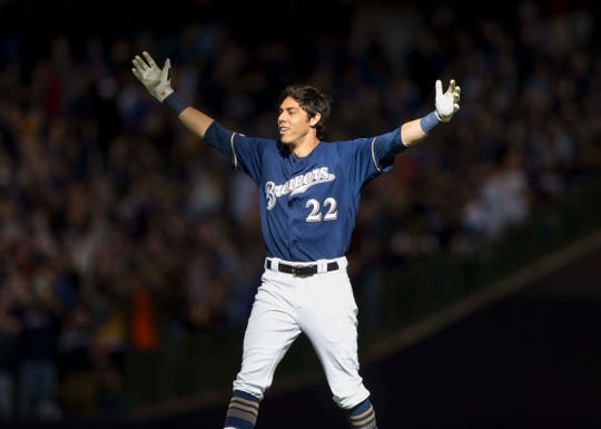 March 31: Brewers outfielder Christian Yelich celebrates after hitting a walk-off double against the Cardinals.