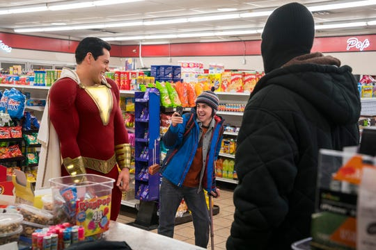 Shazam (Zachary Levi, left) and Freddy (Jack Dylan Grazer) record their heroics even in the middle of a convenience-store robbery.