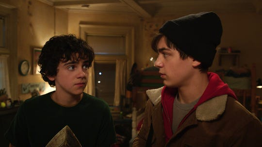 "Freddy (Jack Dylan Grazer, left) teaches new foster brother Billy (Asher Angel) all about superheroes in ""Shazam!"""