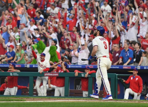 March 30: Phillies right fielder Bryce Harper watches the flight of his home run against the Braves.